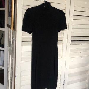 Black sweater dress with turtleneck.